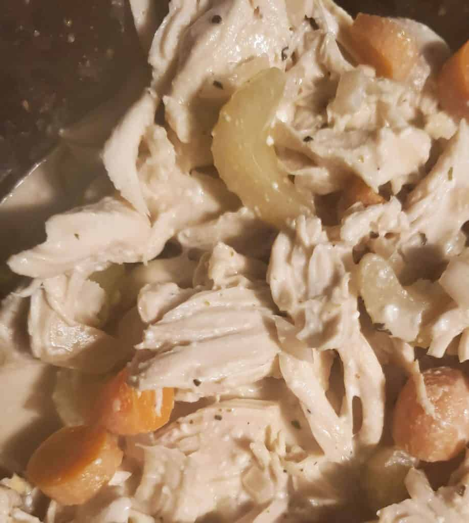 chicken and vegetables cooking in crockpot