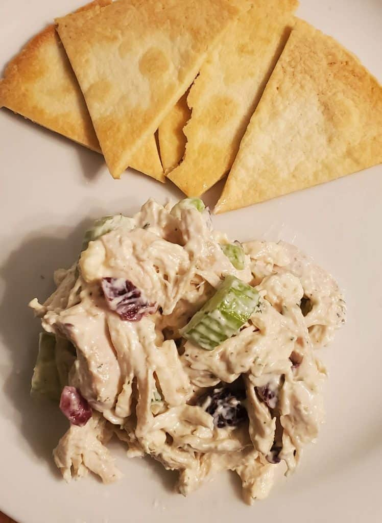 Chicken salad on white plate with homemade tortilla chips