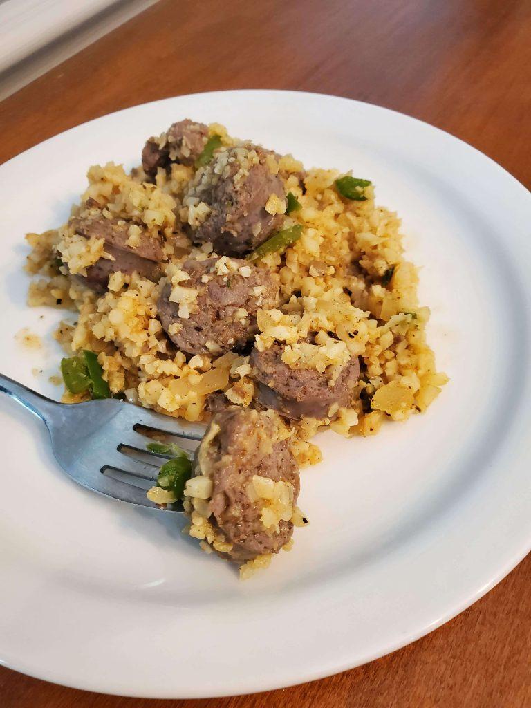 cajun cauliflower rice on white plate