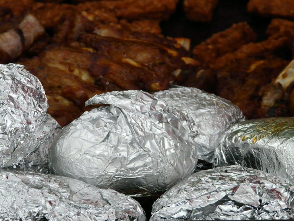 potatoes wrapped in foil on grill