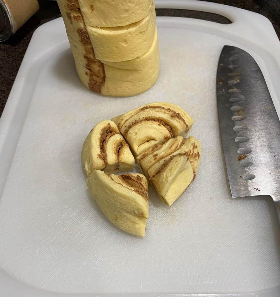 Cinnamon roll cut into quarters